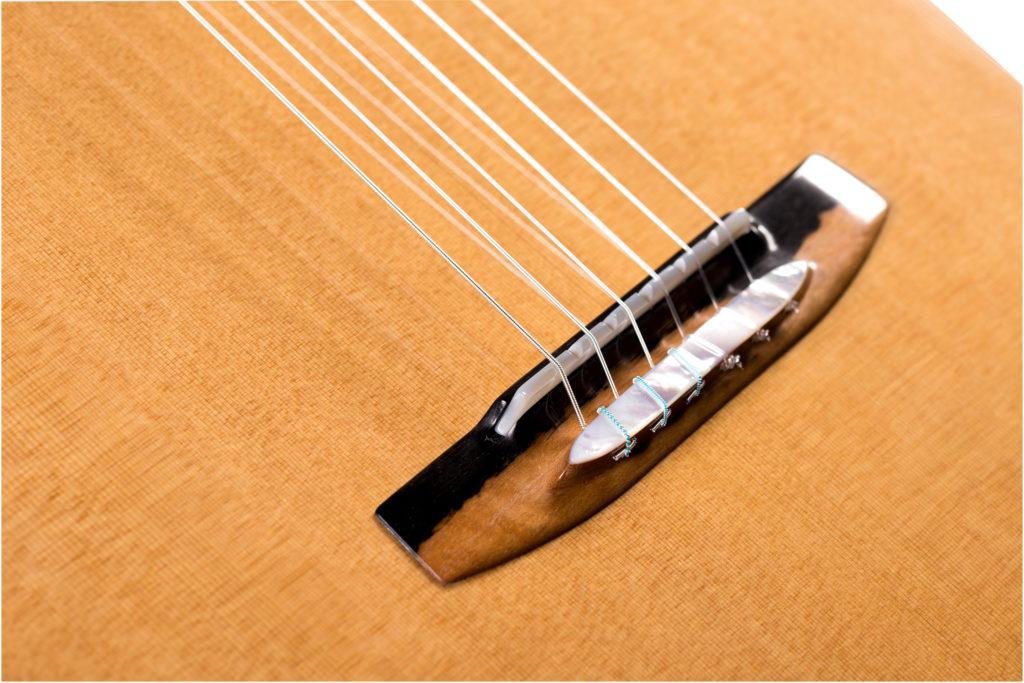 Guitar bridge with sapwood