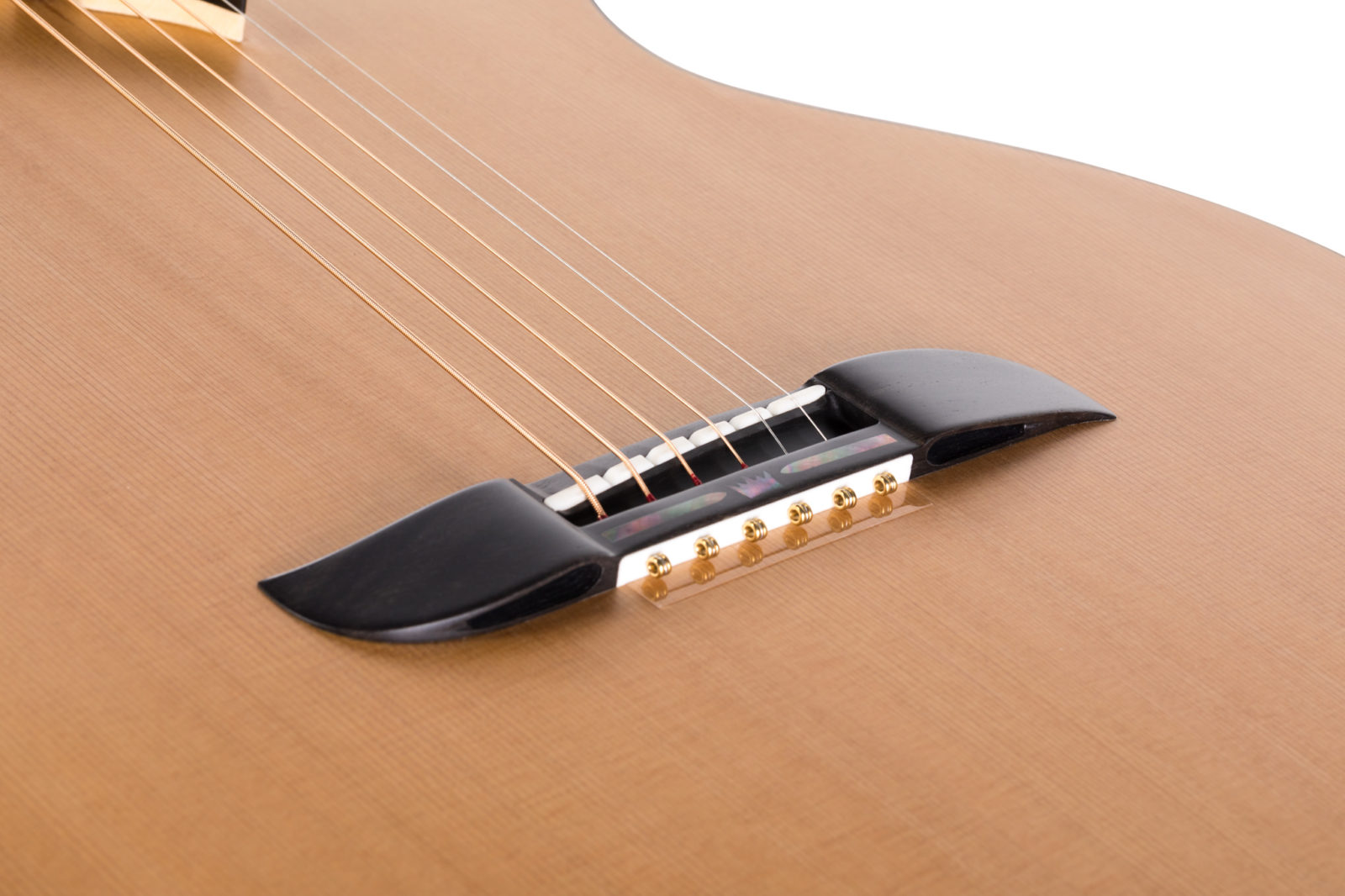 Innovative guitar bridge with drilled holes
